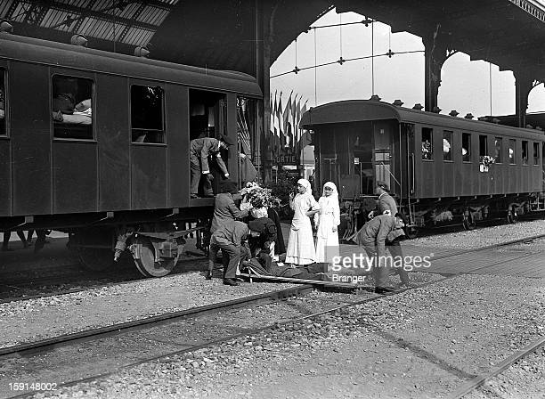 World War I Ambulance drivers unloading disabled soldiers repatriated from Germany by train Lyons September 1915