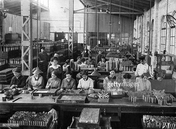 female workers manufacturing cartridge cases in a staterun artillery factory probably 1916/1917