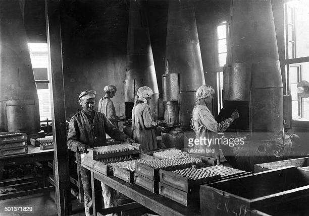 World War I armaments industry in Germany detonator charge fuses are covered with paraffin in a staterun explosives factory 1917