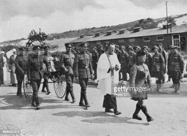 World War I Army chaplain officiating at funeral of nurse killed during air raid on British base near Etables Photo12/UIG via Getty Images