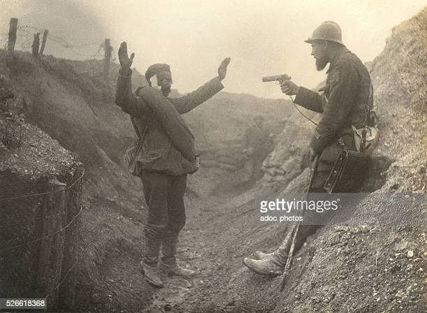 World War I Battle of the Hills A captain of the 1st regiment of zouaves keeps a German wounded at bay during the attack on the Mont Cornillet in...