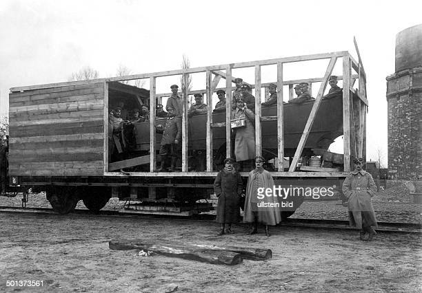 car frame built into a goods wagon On the left its inventor Mr Schneemann probably in 1916