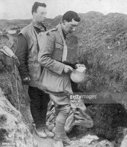 World War I Chaplain of the lst Munsters saying a burial prayer over soldiers killed in their trench by a German shell Photo12/UIG via Getty Images