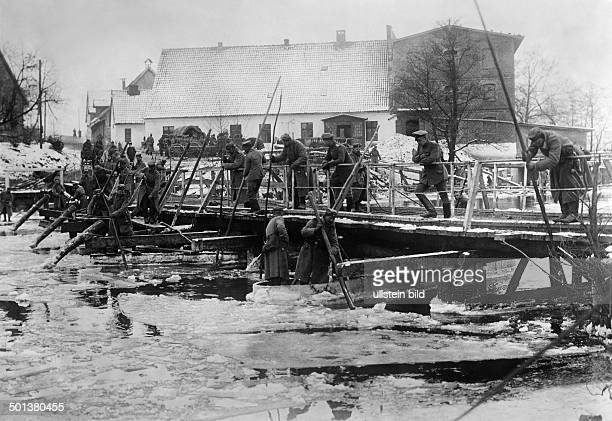 German offensive in Masuria soldiers breaking the ice of the river Angerap standing on a temporary bridge constructed by Russian pioneers probably in...