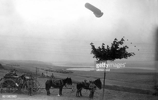 horse and cart of the German army at a lake in Masuria an observation balloon floating above the lake Photo Kuehlewindt 1914