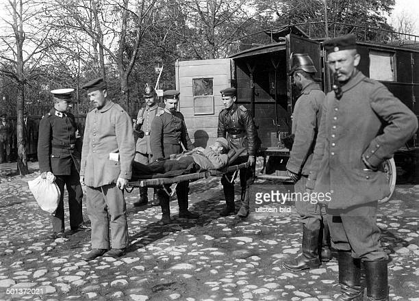 injured German soldier on a stretcher is pushed into an ambulance 1915/16