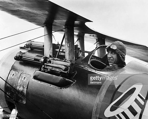 World War I fighter pilot Eddie Rickenbacker known as the ace of aces sits in his Spad XIII fighter plane