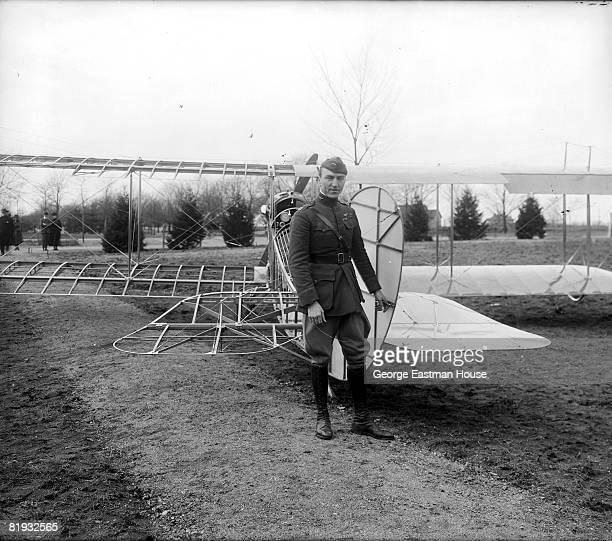 World War I flying ace Eddie Rickenbacker standing next to an airplane exhibit ca1920s United States
