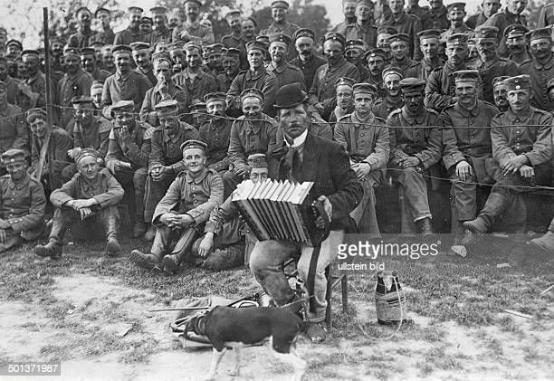 World War I German army welfare services in the back area entertainer playing accordion for the soldiers autumn 1914