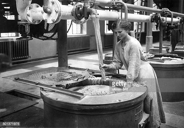 production of gunpowder in a staterun ammunition factory a female worker at a centrifuge containing gun powder undated