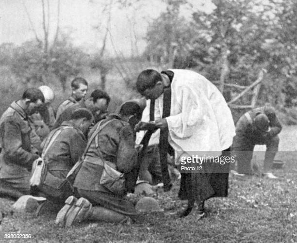 World War I New Zealand troops taking Holy Communion administered by an Army chaplain in the open air