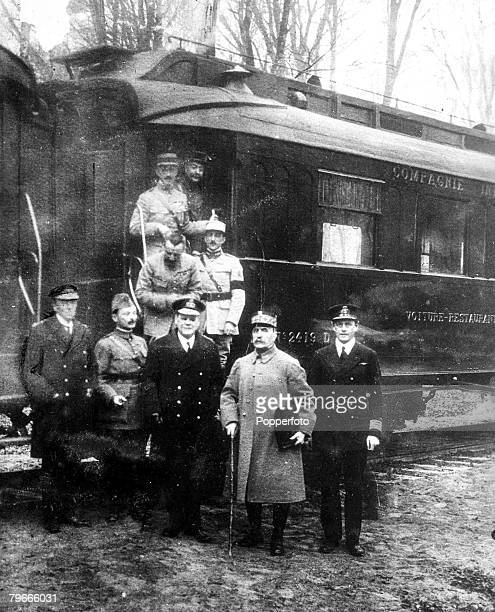 World War I, November 1918, Foreign representatives pose by the railway carriage in which the signing of the armistice took place to end the first...