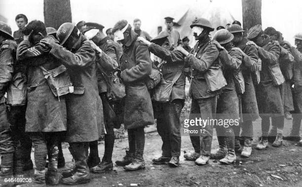 The blind leading the blind Men of the 55th British Division casualties of a poison gas attack walking in single file with hand on shoulder of man in...