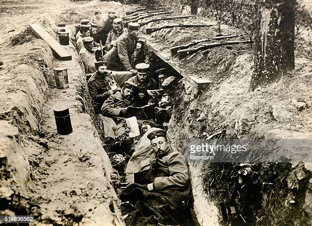 World War I trench Warfare. German Contingent relaxing in a trench during lull in battle.