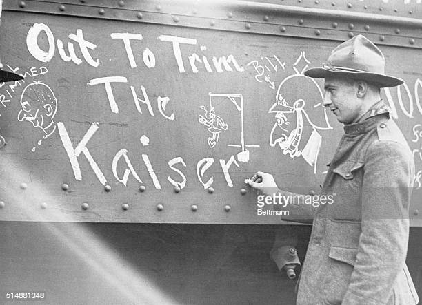 US soldier chalks up ambition of AEF on outside of railroad car undated photograph