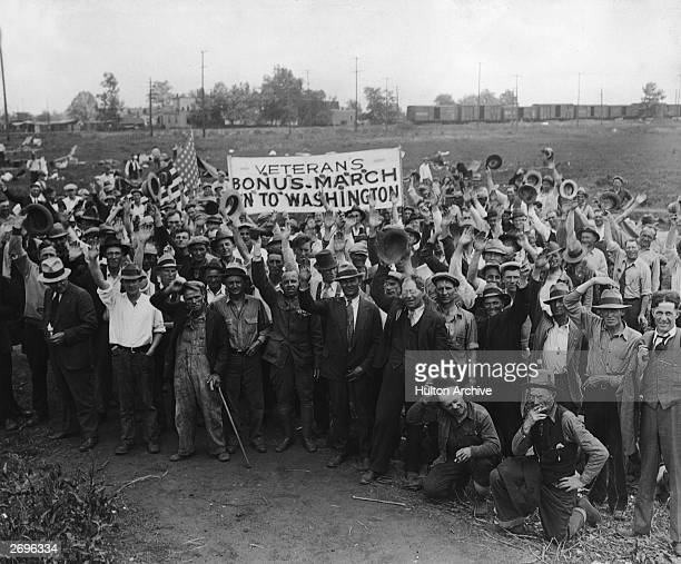 World War I veterans congregate at a railway yard and carry a banner which reads 'VETERAN'S BONUS MARCH ON TO WASHINGTON' St Louis Missouri