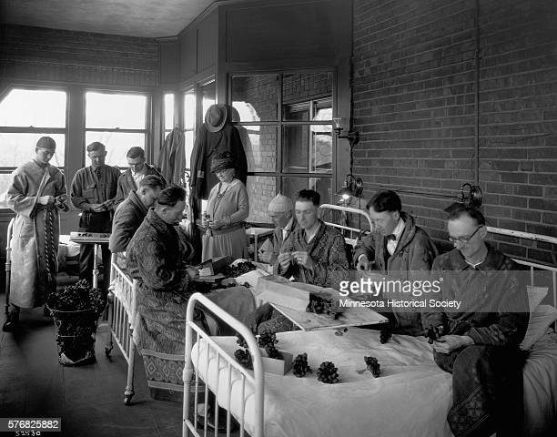 World War I veterans make artificial poppies for Armistice Day in their hospital ward. The ladies of the American Legion Auxiliary will sell them to...