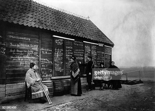 Belgians flee from the combat zones to the Netherlands Refugees from Antwerp write their new addresses onto a wooden shack to inform relatives that...