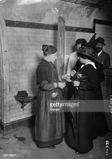World War I Woman checking tickets in a subway station 1914
