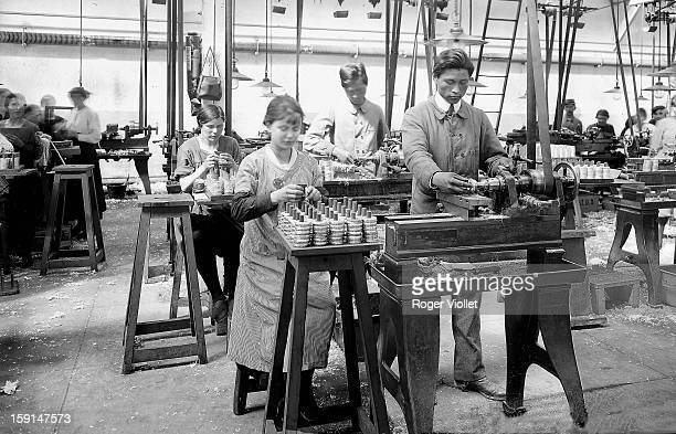 World War I Women and Chinese workers working in a French weapon factory