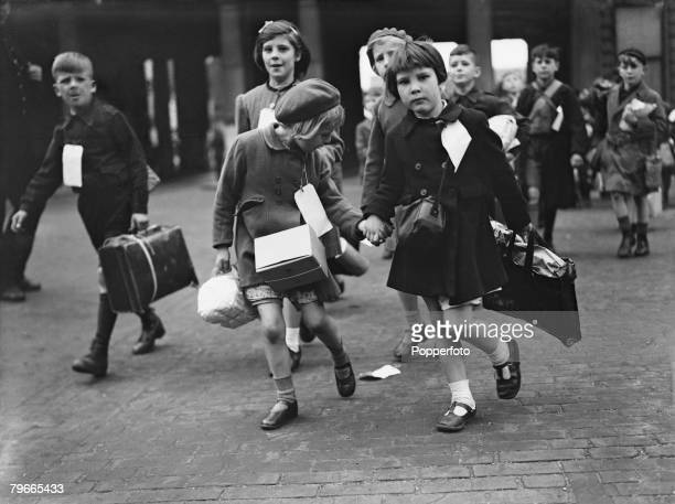 World War II 11th June 1944 London England Little girls carry their belongings to their train at Euston station en route to their evacuation to the...