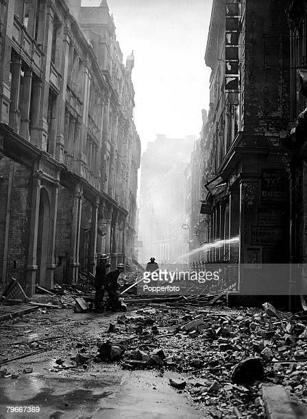 World War II 11th September The Battle of Britain Firemen direct their water hoses onto fire damaged city buildings after an air raid