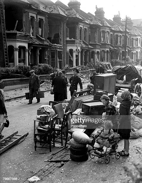World War II 14th September People with their furniture and belongings in a street in the London area with their damaged homes in the background
