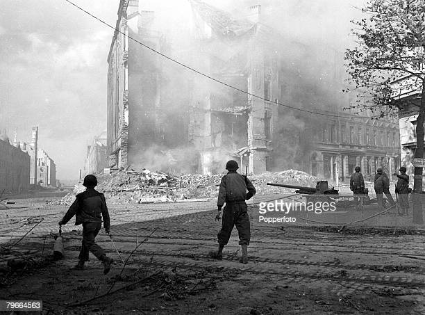 World War II 15th October 1944 American troops fighting their way in the blazing streets of Aachen Germany during the second World War