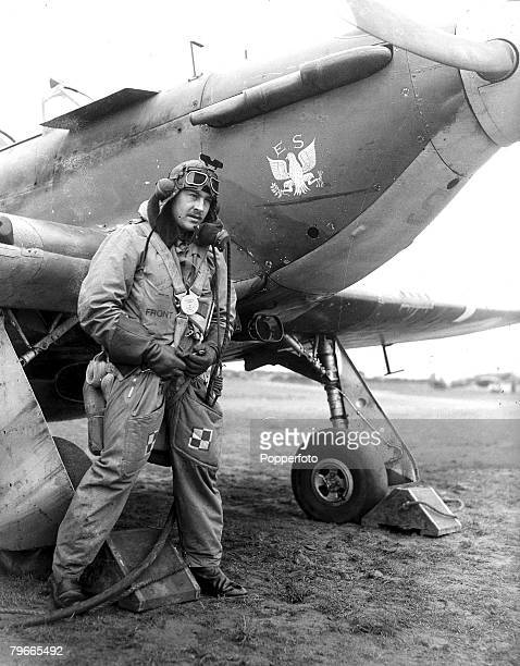 World War II 18th March 1941 Pilot of the RAF all American fighter Eagle Squadron pictured with his hurricane plane Somewhere in England