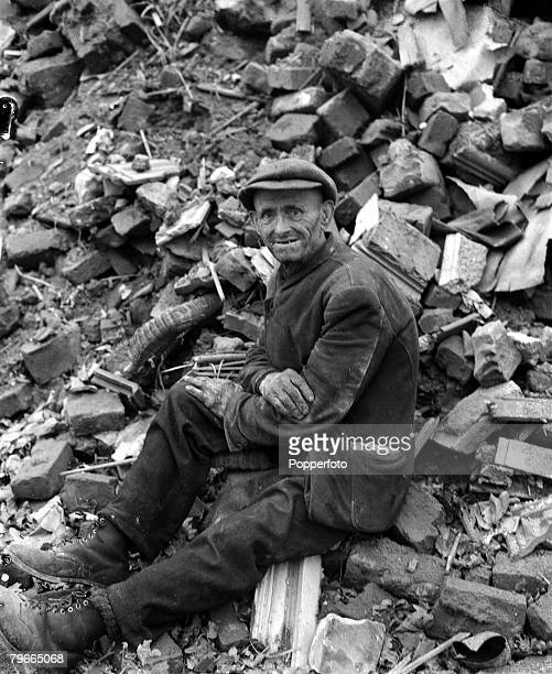 World War II 18th October 1944 Aachen Germany A German civilian sits dazed in the ruins of his home