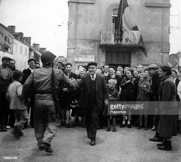 World War II 21st June 1944 Barneville France The Mayor and inhabitants of Barneville greet American troops who liberated their town after the Allied...