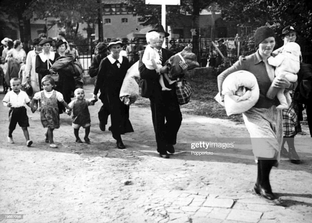 World War II, 24th August 1939, German men and women carrying their children and bundles of possessions as the arrived in Germany from Poland