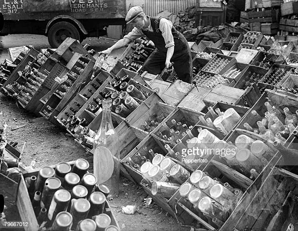 World War II, 25th June 1940, Sorting bottles into their 92 grades at one of London's most productive salvage centres in the East End of the city.