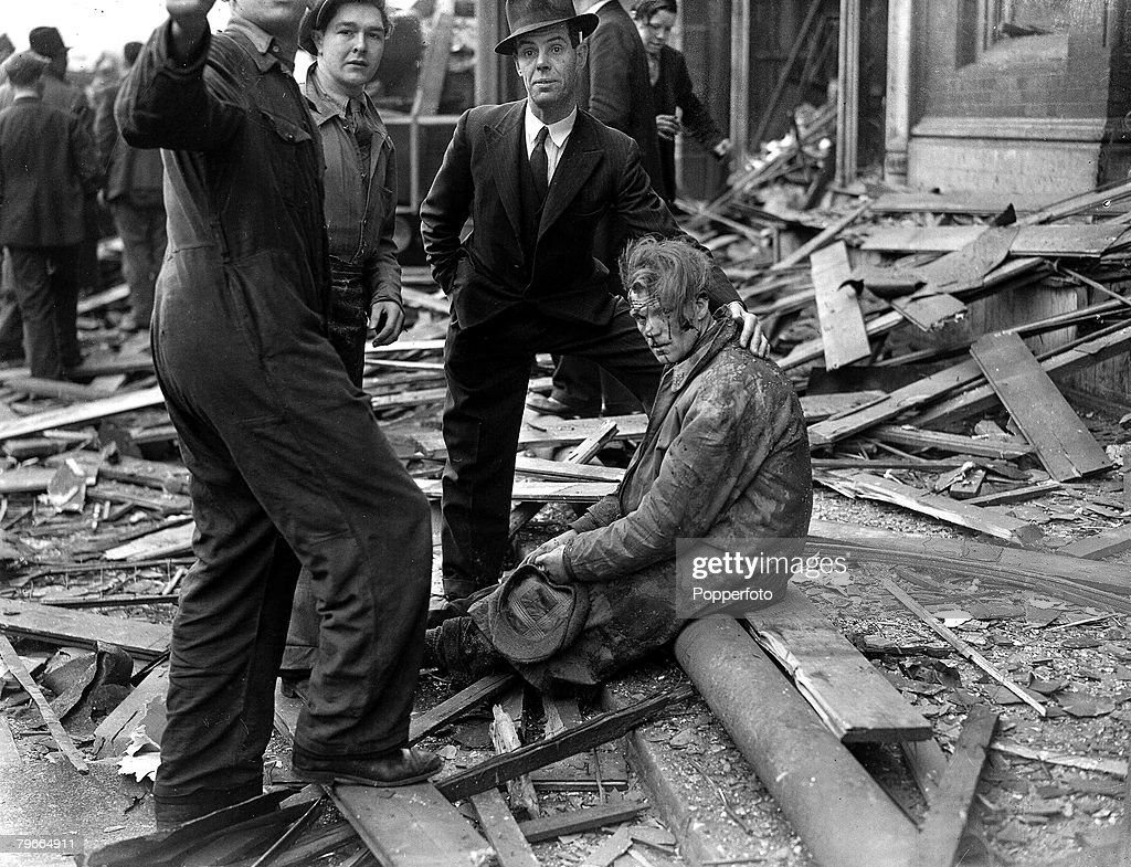 World War II, 26th April 1945, One of London last and worst V2 incidents, A civilian casualty sits among the debris of Smithfield market after one of the last V2 rockets had crashed