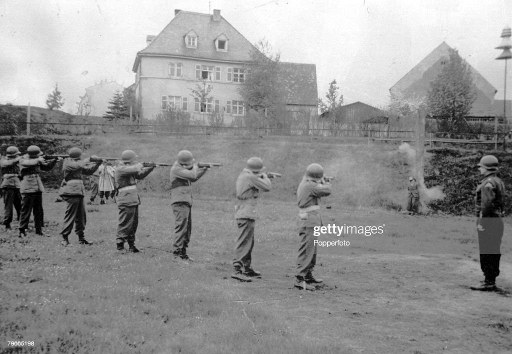 World War II, 28th April 1945, The first German spy to be tried by the US 7th Army Military Commission is executed by a firing squad, He was Richard Jarczyk, Volksrenadier, who admitted that he had been trained for sabotage and espionage behind the Allied : News Photo