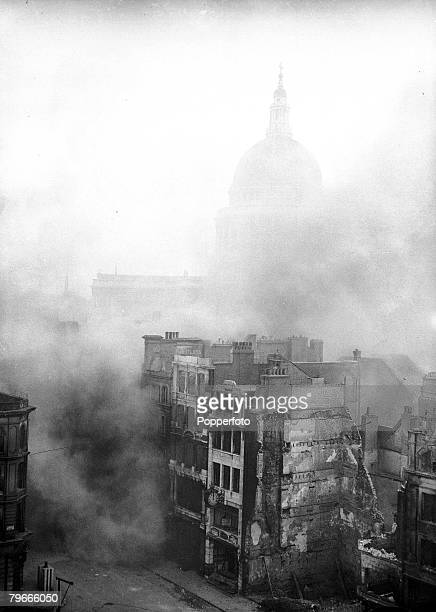 World War II 3rd January 1941 London England St Pauls Cathedral is shrouded in smoke from damaged bombed buildings after a German bombing raid