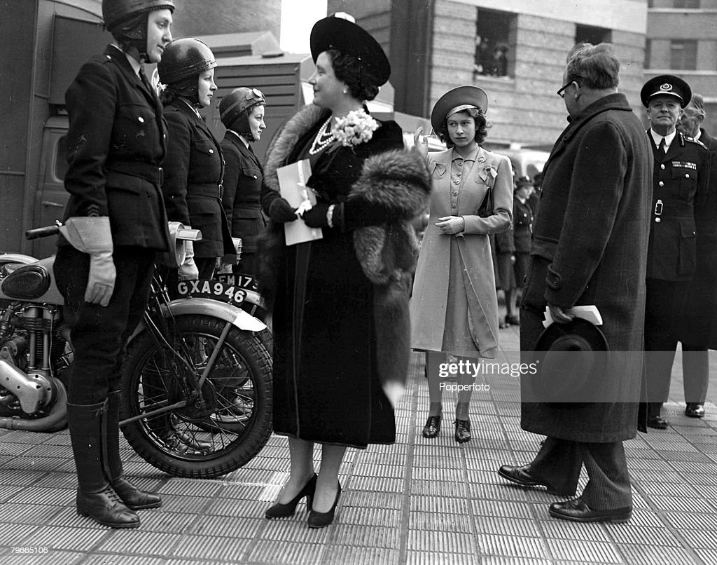 World War II, 6th December 1944, Queen Elizabeth, later the Queen Mother, accompanied by Princess Elizabeth, later Queen Elizabeth II, (centre) and Herbert Morrison (right) the minister of home security talk to women motorcyclists during their visit to th : News Photo