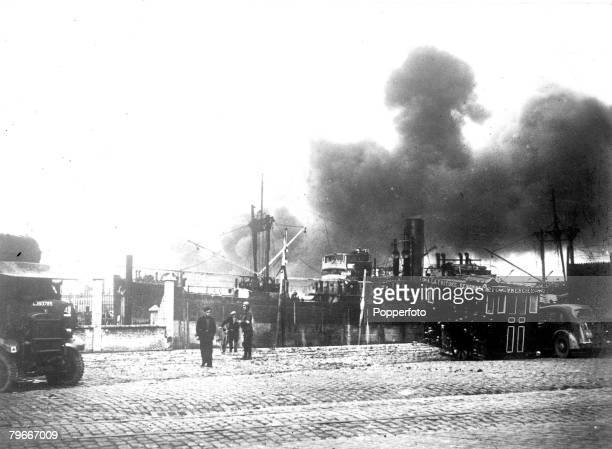 6th June 1940 Clouds of dense smoke rising from the bombarded part of Dunkirk where the Allied evacuation was successfully completed despite heavy...