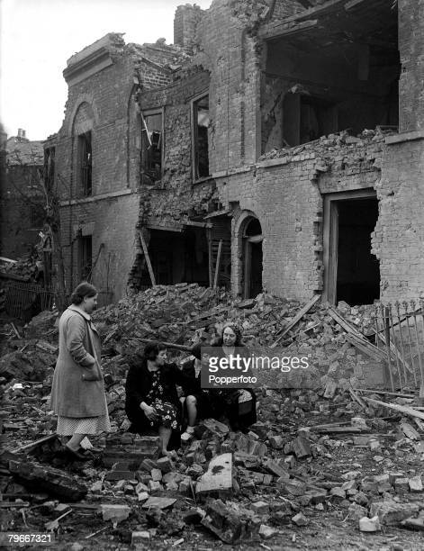 World War II 8th September Women now homeless sit among the debris of their houses in a poor area of London after a huge air raid by the German...
