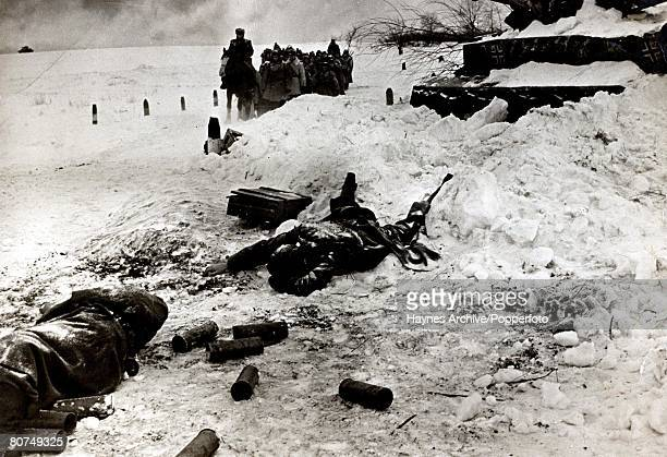 World War II A dead Russian soldier lies by a wrecked German tank as a troop of Russian soldiers pass during the battle of Stalingrad