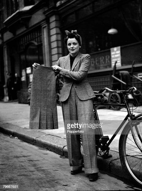 World War II, A girl cyclist wearing coat and trousers, holding a skirt, which she changes into when she has cycled to work, This popularity in...