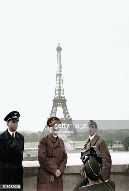 World War II Adolf Hitler with Albert Speer and Arno Breker posing front of the Eiffel Tower in Paris In June 1940 Coloured photograph