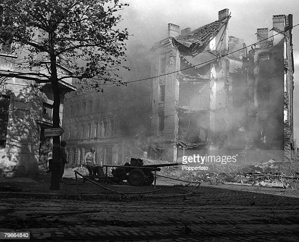 World War II American troops and gun mounted on the corner of Bismarck Street Aachen The German town became a blazing ruin 15th October 1944