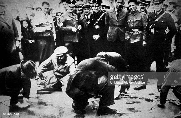 Jews being forced to scrub the streets of Vienna in 1938