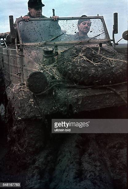 World War II Army Group South German soldiers in a jeep on muddy terrain in the Ukraine no further details spring 1942 Photographer Wolff Tritschler...