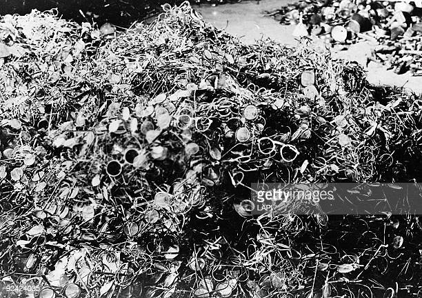 World War II Auschwitz concentration camp pile of glasses