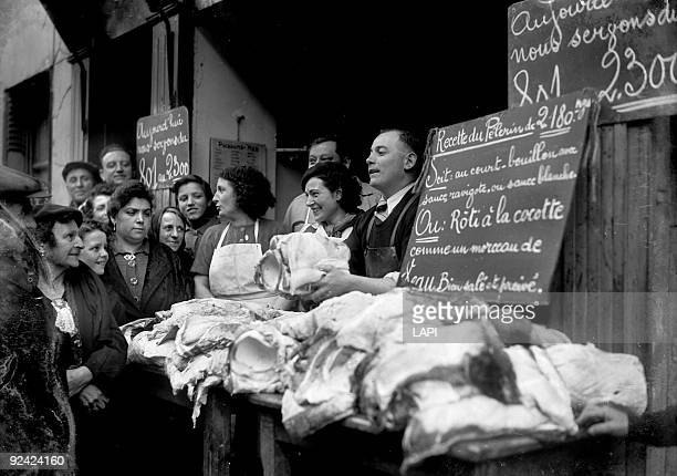 World War II Basking shark for sale at a fishmonger's Paris April 1943