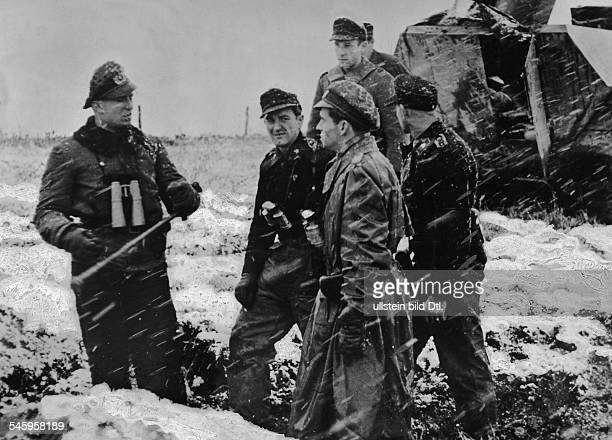 World War II Battle of the Bulge German offensive from briefing of a German tank division in a snow flurry around
