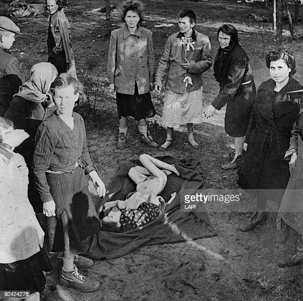 World War II BergenBelsen concentration camp Women burying a woman starved to death