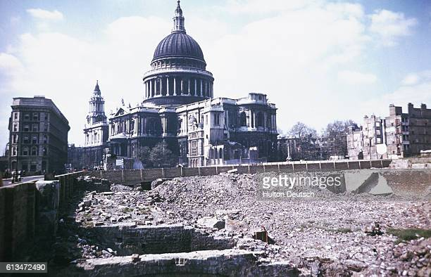 World War II bomb damage reduces buildings to rubble near Saint Paul's Cathedral in London Engand